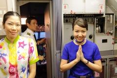 Crew members of Bangkok Air. BANGKOK - OCT 25: crew members (focus on woman in blue dress) of Bangkok Air  on October 25, 2011 in Bangkok, Thailand. Bangkok Stock Image