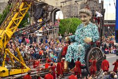 Crew Of Royal De Luxe Theatre Controlling Giant Mechanical Doll Stock Photos
