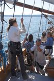 The crew rigs the sails of the Hawaiian Chieftain Royalty Free Stock Photography