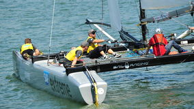 Crew of SAP Extreme Sailing Team steering boat at Extreme Sailing Series Singapore 2013 Royalty Free Stock Photography