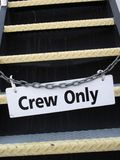 Crew only sign. On a chain loking stairs Royalty Free Stock Photos