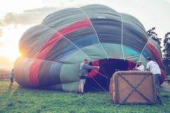 Crew at sunset prepare hot air balloon Stock Image