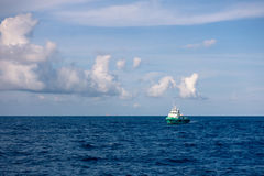 Crew and Supply Vessel offshore or Supply Boat in the sea Stock Photography