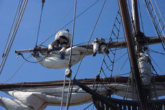 Crew unfurls a sail Stock Image