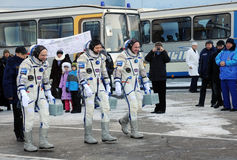 Crew Walk Out. Expedition 31 crew (D.Pettit, O.Kononenko, A.Kuipers) walk out to report that they are ready for the flight to International Space Station on the Royalty Free Stock Image