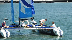 Crew of Wave Muscat steering boat at Extreme Sailing Series Singapore 2013 Royalty Free Stock Image