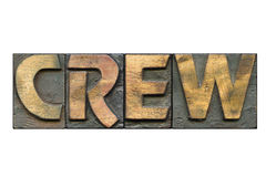 Crew word isolated. Crew word made from vintage bold letterpress blocks isolated on white stock photography