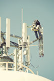 Crew working on the cell tower Stock Images