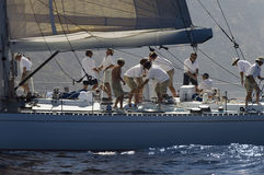 Crew Working On Sailboat. Side view of crew members working on sailboat stock images