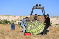 The crew wrapping Hot Air Balloon after landing. Stock Images