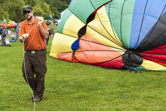 Crewman helping inflate hot air balloon Stock Photos