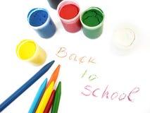 Creyones y water-colors coloridos, de nuevo a escuela Foto de archivo
