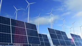 Crezca el panel solar que desarrolla con las turbinas de viento que generan energía almacen de video