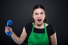 Crezy young employee woman shouting frustrated. After talking on the phone Royalty Free Stock Image