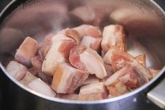 Pork frying in the pan cooking recipe food meat meal Sao Paulo Brazil stock photography