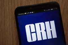 CRH logo displayed on a modern smartphone. KONSKIE, POLAND - AUGUST 18, 2018: CRH logo displayed on a modern smartphone royalty free stock photo