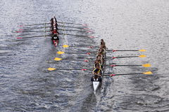 CRI (left) and Merion Mercy (right) races in the Head of Charles Regatta Women's Youth Eights Stock Image