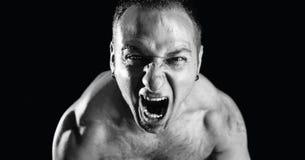 Cri perçant de rage Photo libre de droits