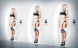 Criada atractiva del traje del cyborg de tres hembras Foto de archivo libre de regalías