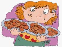 Criança ávida com projeto cômico recentemente cozido do humorista das cookies Foto de Stock Royalty Free