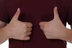 A criança é vencedor e tem o sucesso, mostrando os polegares acima Foto de Stock Royalty Free