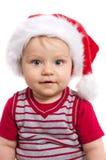 Criança adorável do Natal em um chapéu vermelho Imagem de Stock