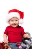 Criança adorável do Natal em um chapéu vermelho Imagens de Stock Royalty Free