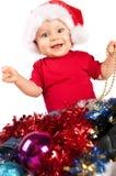 Criança adorável do Natal em um chapéu vermelho Fotografia de Stock