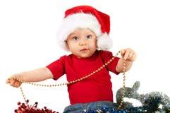 Criança adorável do Natal em um chapéu vermelho Fotos de Stock Royalty Free