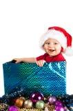 Criança adorável do Natal em um chapéu vermelho Imagens de Stock