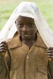Criança africana em um dia chovendo Fotografia de Stock Royalty Free