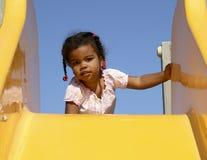 Criança africana na corrediça Fotografia de Stock Royalty Free