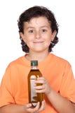 Criança agradável com o frasco de petróleo verde-oliva foto de stock royalty free