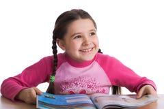 Criança alegre com livro Fotografia de Stock