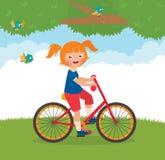 A criança alegre monta uma bicicleta Imagens de Stock