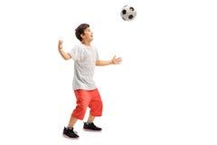 Criança alegre que joga o futebol foto de stock royalty free