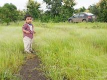 Criança asiática no campo Foto de Stock Royalty Free