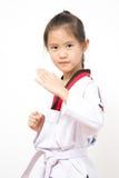 Criança asiática pequena na ação de combate Fotos de Stock Royalty Free