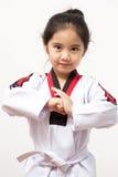 Criança asiática pequena na ação de combate Imagens de Stock
