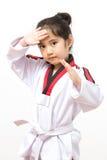 Criança asiática pequena na ação de combate Imagens de Stock Royalty Free
