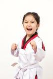 Criança asiática pequena na ação de combate Fotografia de Stock