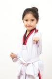 Criança asiática pequena na ação de combate Imagem de Stock
