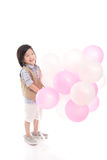 Criança asiática que guarda balões cor-de-rosa e brancos Imagens de Stock Royalty Free