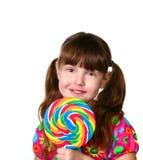 Criança bonita com Lollipop fotografia de stock royalty free