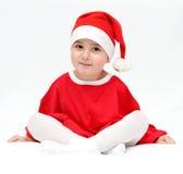 Criança bonita no chapéu de Papai Noel Fotografia de Stock