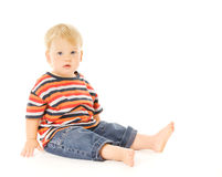 Criança bonita que sitiing Fotografia de Stock Royalty Free