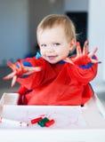 Criança bonito com mãos pintadas Imagens de Stock Royalty Free