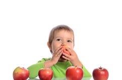 Criança bonito com maçãs vermelhas Imagens de Stock Royalty Free