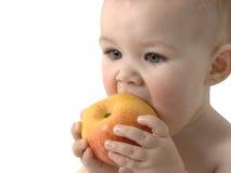 A criança bonito come a maçã Fotografia de Stock Royalty Free