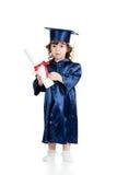 Criança bonito na roupa do academician com rolo fotografia de stock